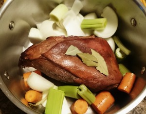 Ham hock in a pot with mire poix awaiting water.