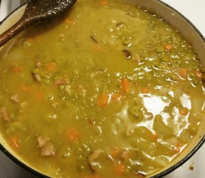 Split pea soup cooking in a dutch oven.
